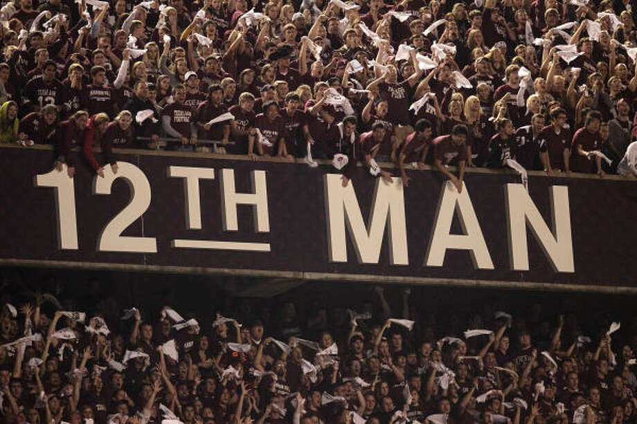 The Texas A&M 12th Man screams and hollers during the fourth quarter. Photo: Karen Warren, Chronicle