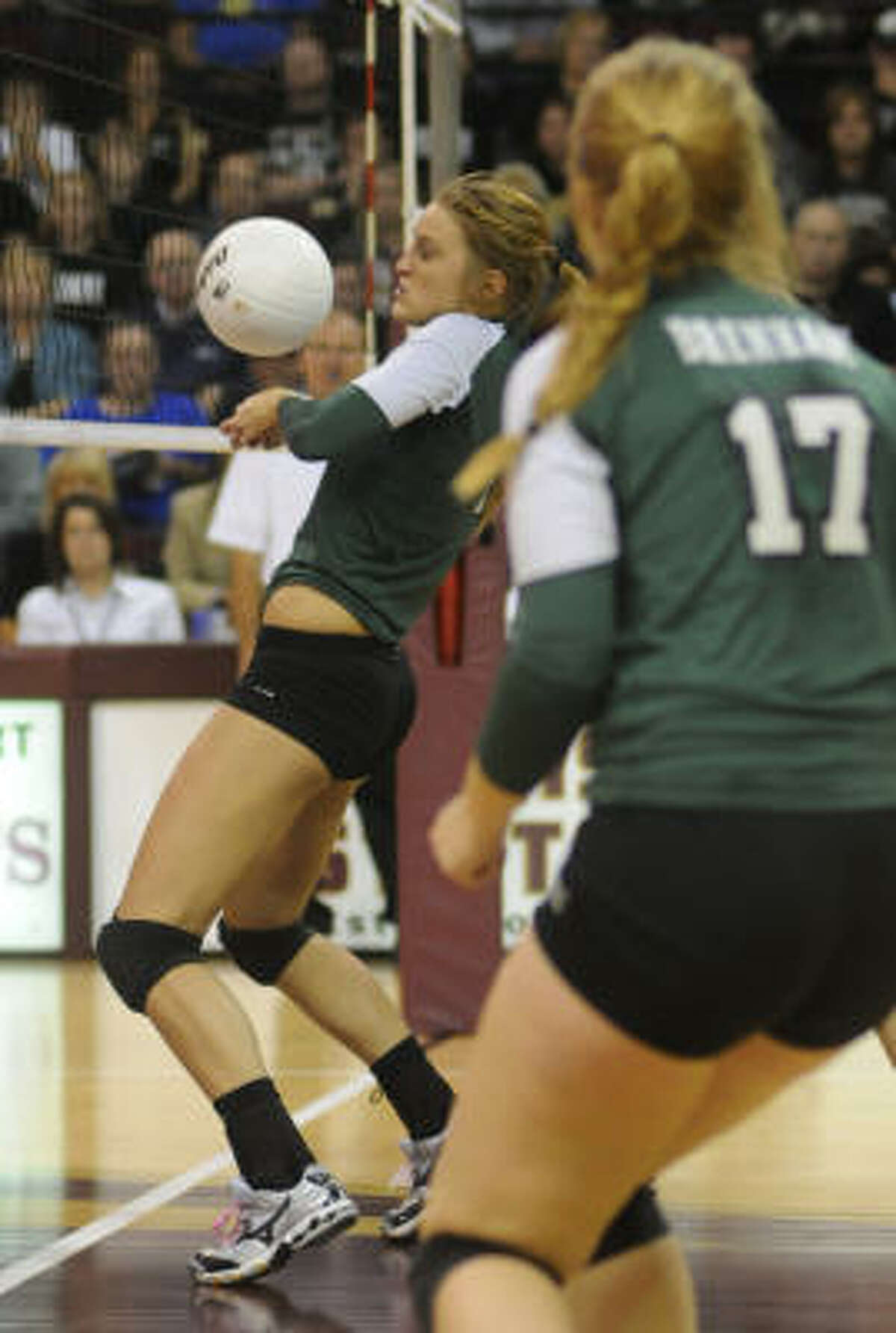Brenham sophomore Kelsey Weynand saves a ball at the net.