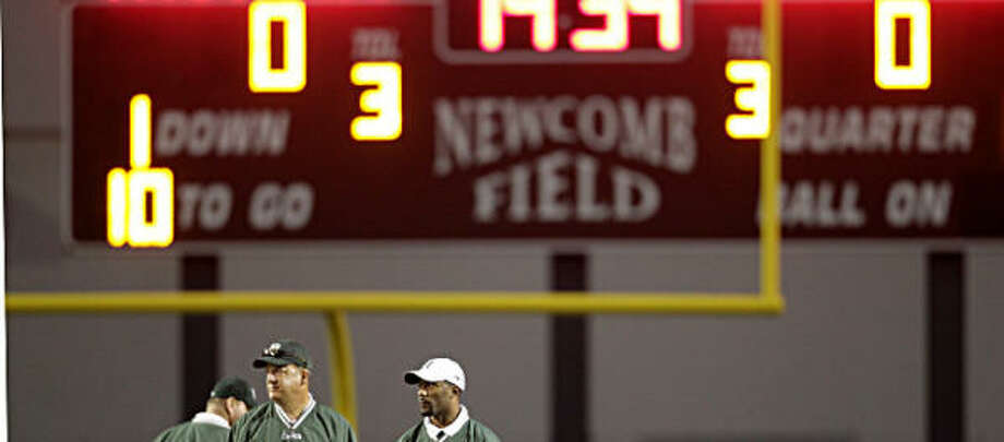Coaches for Hightower stand on the field before the start of the game. Photo: Karen Warren, Chronicle