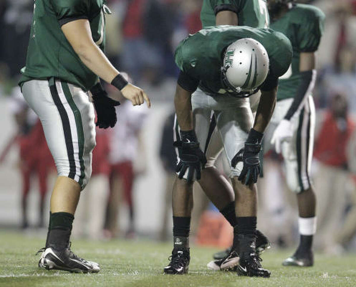 Hightower's Clyde Lee (5) reacts after getting tackled and fumbling the ball for a turnover.