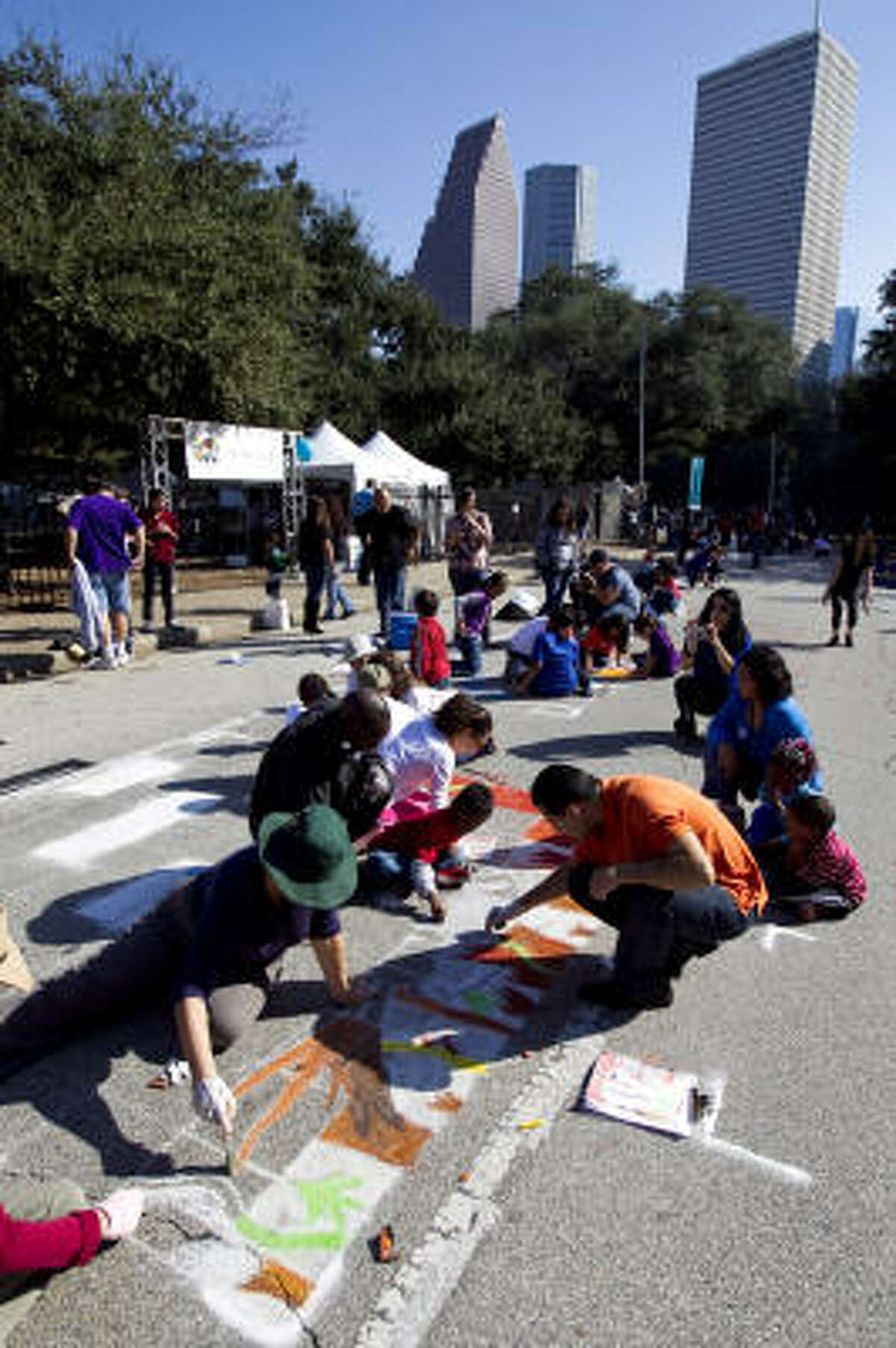 Two hundred and fifty artists participate in the Via Colori street painting festival in downtown Houston.The festival's theme is The Color of Sound. Proceeds benefit hearing impaired kids.