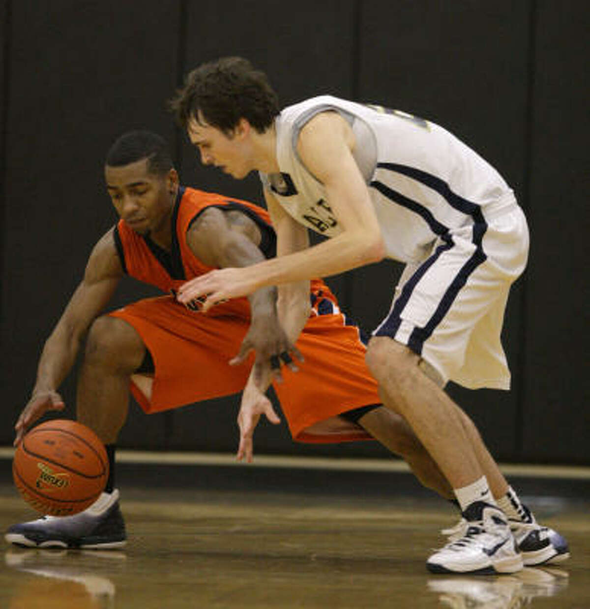Bush's Rodshard Davis, left, tries to dribble away from Second Baptist's Julien Person.
