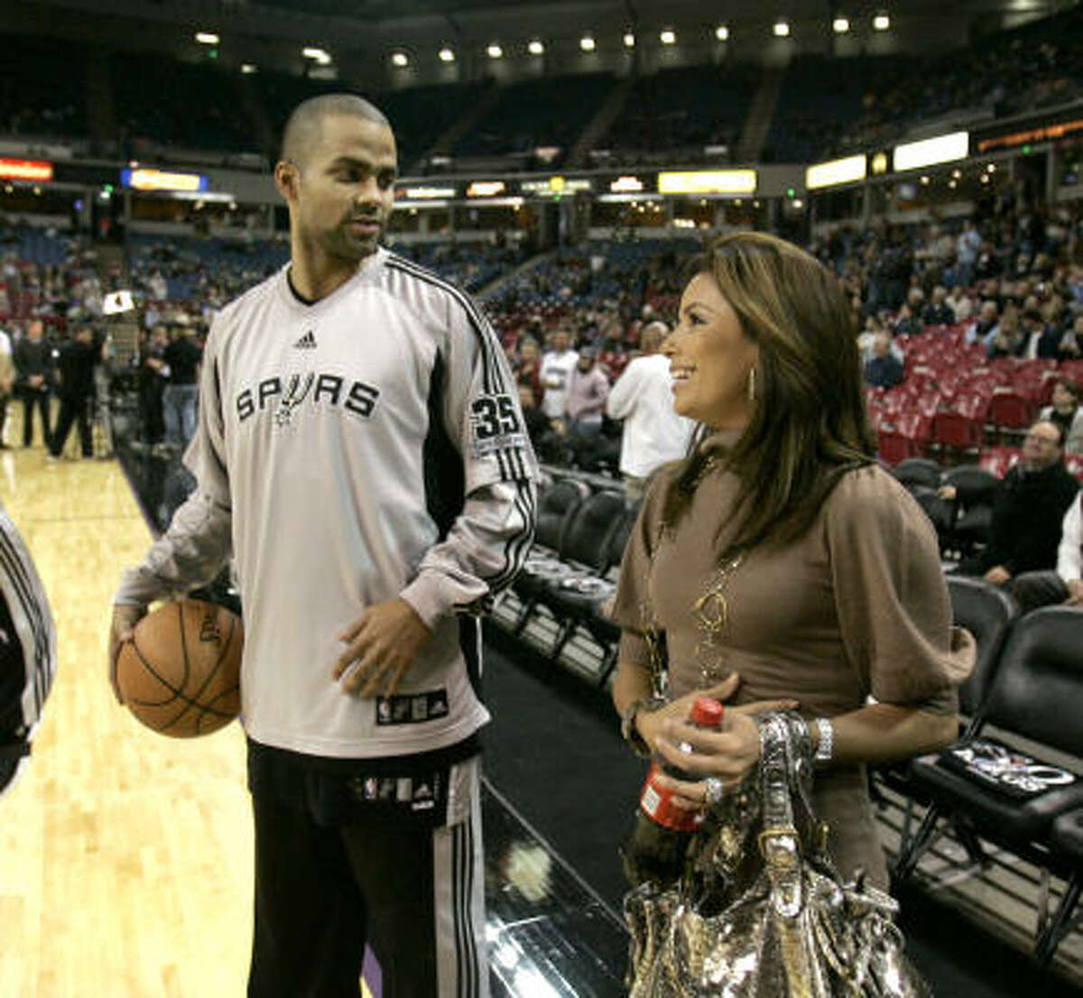 December 2007: Parker denies the published claims by a French model that she had an affair with him. He says he has never even met her. He sues the celebrity gossip website, which a few months later publicly apologizes, declaring it had been misled by the model. Days before, Parker talks to his wife, Eva Longoria Parker, before a Spurs game in Sacramento, Calif. on Nov. 26.