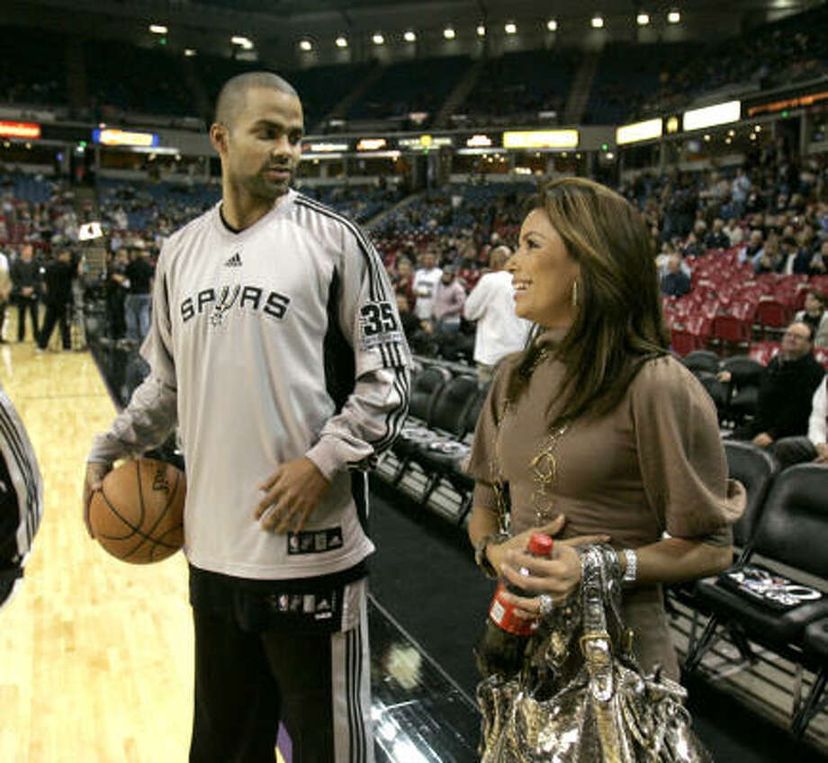 December 2007: Parker denies the published claims by a French model that she had an affair with him. He says he has never even met her. He sues the celebrity gossip website, which a few months later publicly apologizes, declaring it had been misled by the model. Days before, Parker talks to his wife, Eva Longoria Parker, before a Spurs game in Sacramento, Calif. on Nov. 26. Photo: Rich Pedroncelli, AP