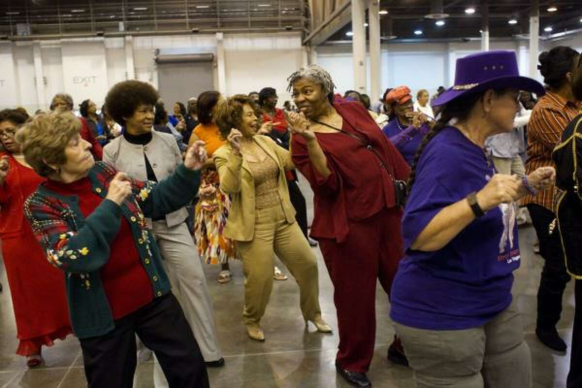 Vicky Dumah, 52, with the Houston Urban Line Dancing Association, leads a group of seniors including Yvonne Crawford, 75, in a dance.