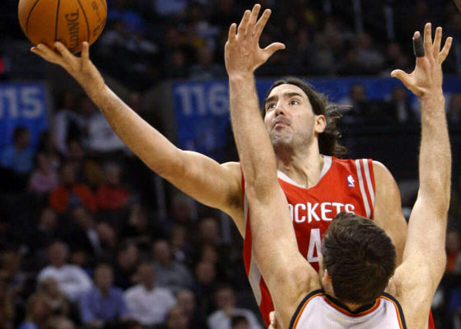 Nov. 17: Thunder 116, Rockets 99 Rockets forward Luis Scola shoots over Thunder center Nick Collison during the first quarter of Wednesday night's game in Oklahoma City. Scola scored a game-high 26 points, but it wasn't enough to keep the Rockets from losing their second straight game. Photo: Sue Ogrocki, AP