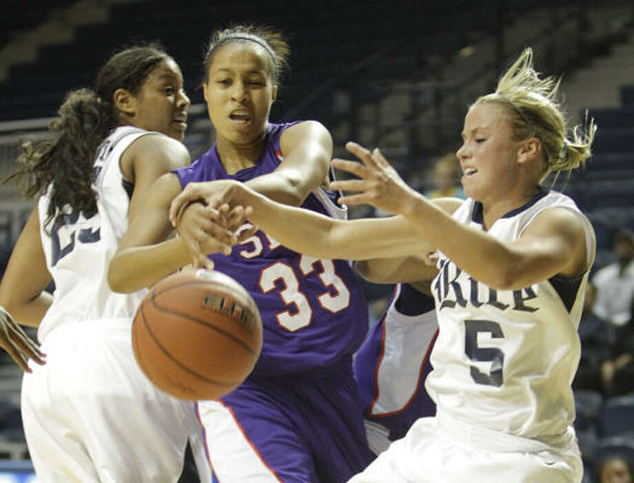 Nov. 17: Rice 59, SFA 54Rice's Jessica Goswitz (5) fights with SFA's Amina Sawyer (33) for control of the ball during the first half of Wednesday night's game at Tudor Fieldhouse. Photo: Karen Warren, Chronicle