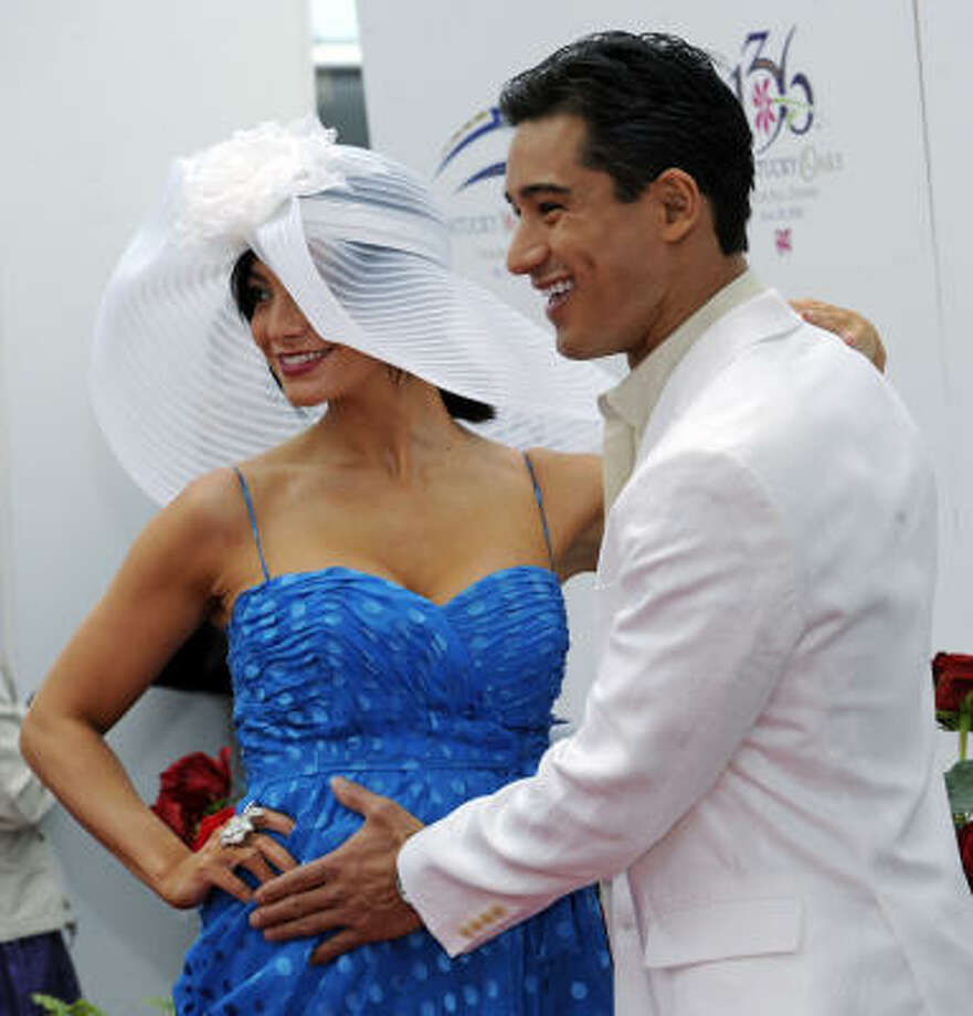 Married: Mario Lopez and his longtime girlfriend, Courtney Mazza, were married on Dec. 1. The lovebirds are shown here when Courtney was pregnant with their daughter, who is now 2 and was a flower girl in their wedding.  Photo: Gail Kamenish, AP