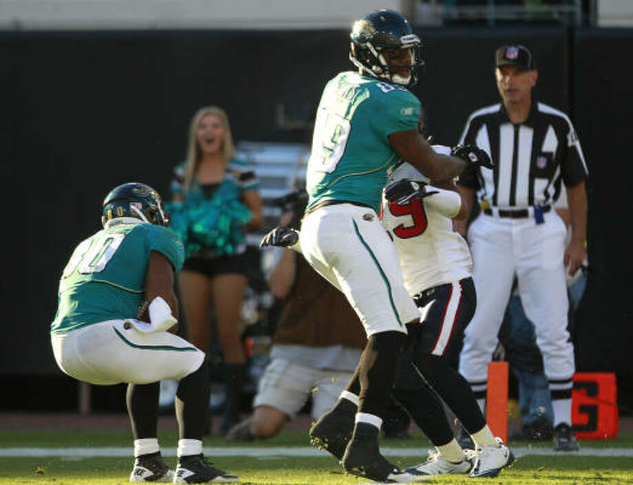 Nov. 14, 2010 Jaguars wide receiver Mike Thomas comes down with a 50-yard touchdown reception on the final play after Texans cornerback Glover Quin tipped it to him. The Jaguars beat the Texans 31-24. Photo: Brett Coomer, Chronicle