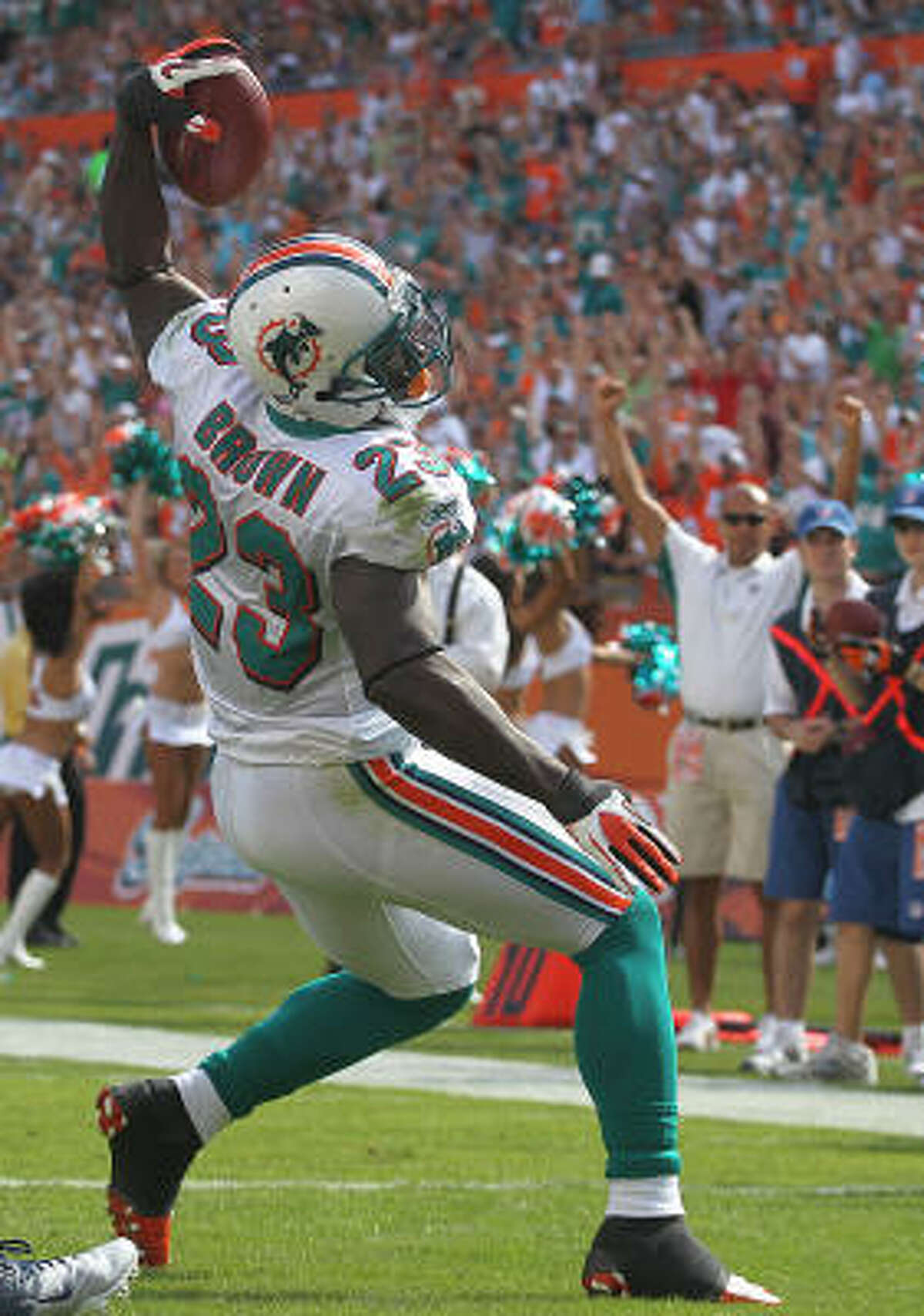 Dolphins 29, Titans 17 Dolphins running back Ronnie Brown spikes the ball after scoring a touchdown in the first quarter.