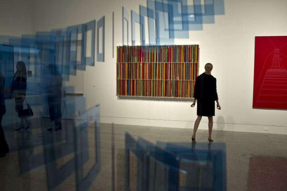 Guests enjoy the art before a VIP dinner celebrating the opening of the Museum of Fine Arts, Houston exhibit Cosmopolitan Routes: Houston Collects Latin American Art. Photo: James Nielsen, Houston Chronicle