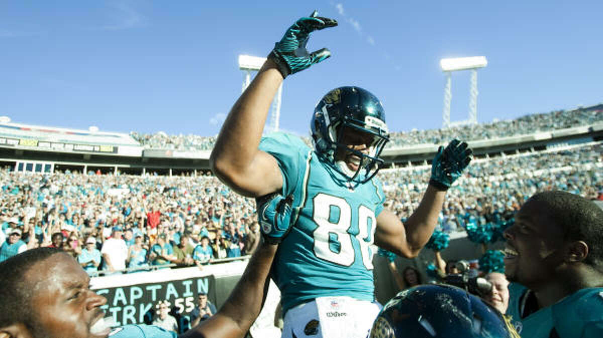 Jaguars wide receiver Mike Thomas is lifted on his teammates' shoulders while celebrating his 50-yard game-winning touchdown catch.