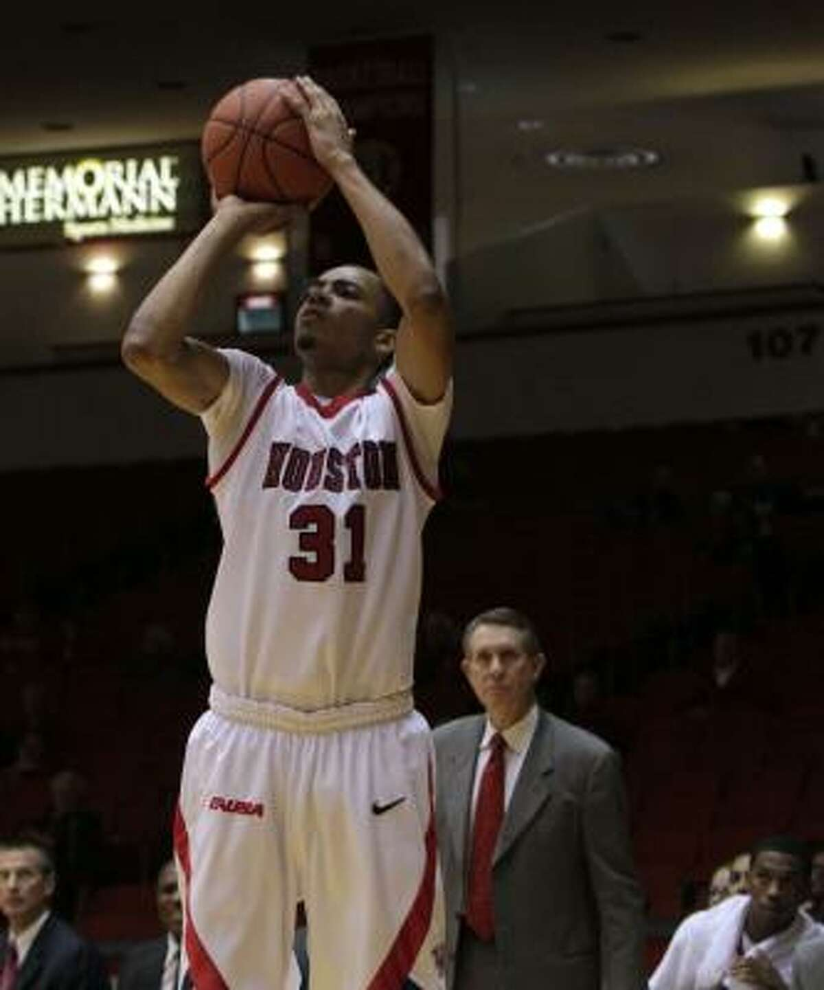 Houston's Adam Brown puts up a three-point shots against Alcorn State in the second half.