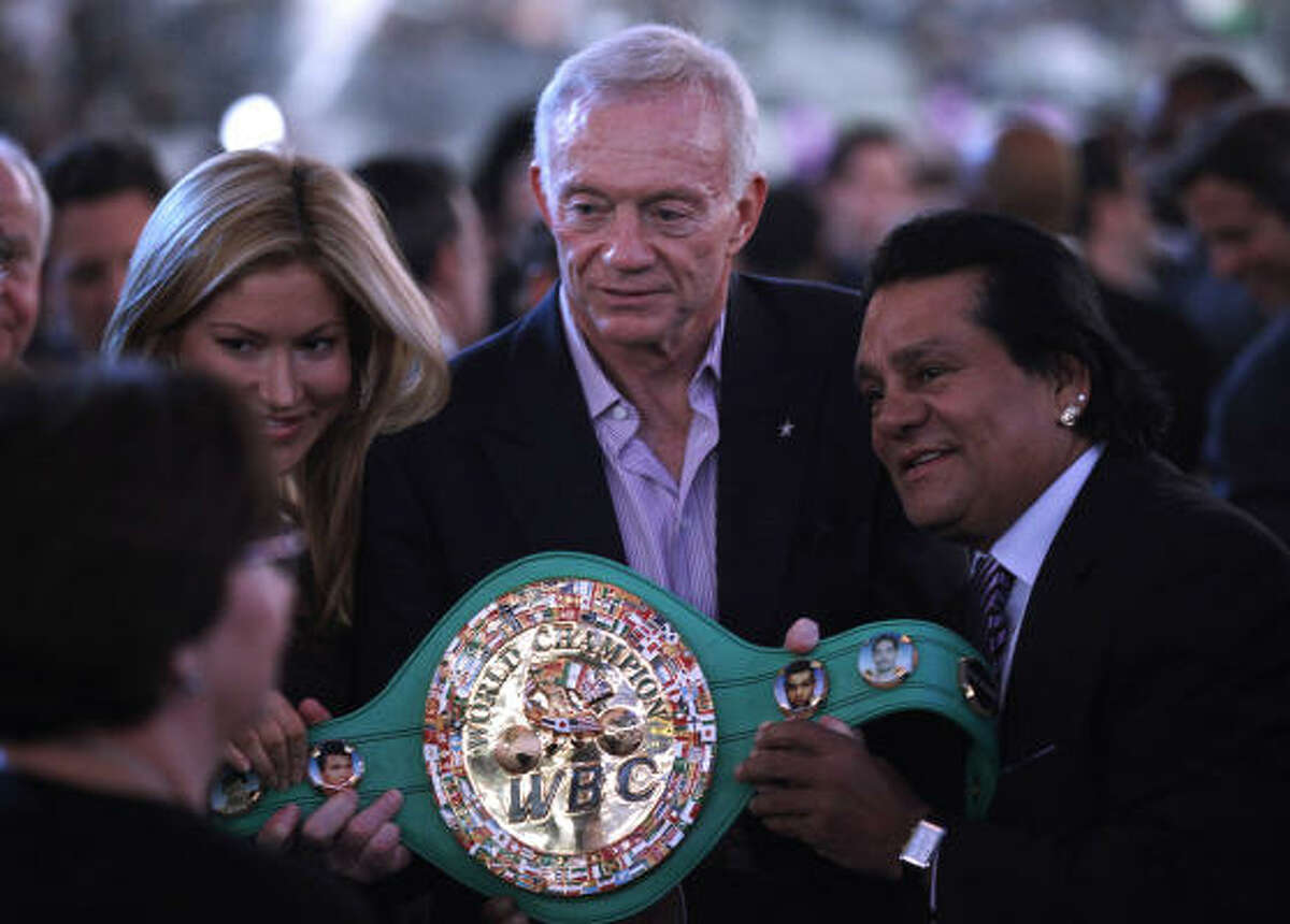 Dallas Cowboys owner Jerry Jones poses with the WBC super welterweight title belt before the Manny Pacquiao and Antonio Margarito boxing match.