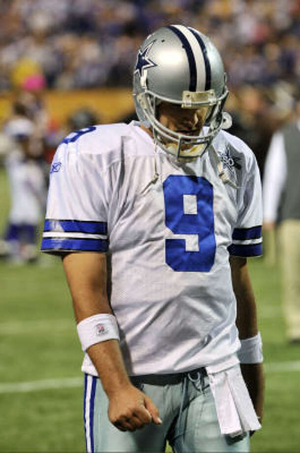 Tony Romo and the Cowboys could take solace in the playoff run of the 1983 Oilers. Photo: Jim Mone, AP