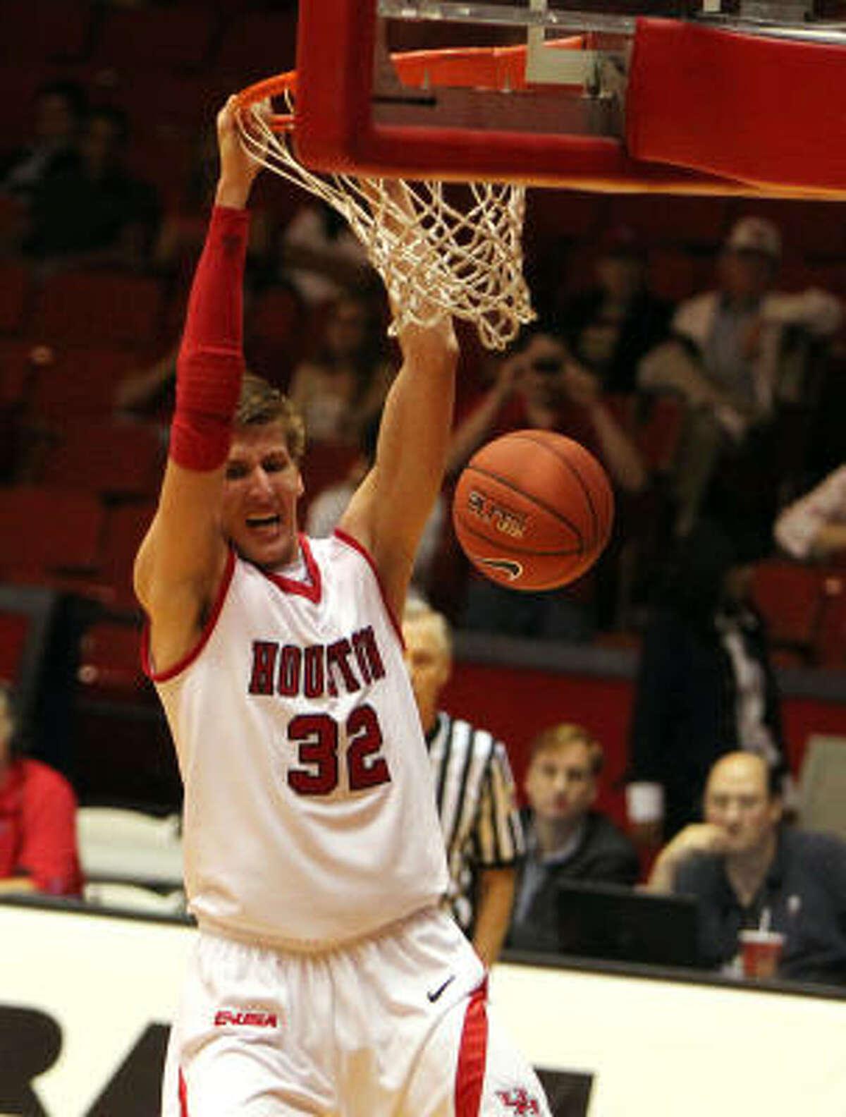 Houston's Kirk Van Slyke dunks the ball against Nicholls State during overtime.
