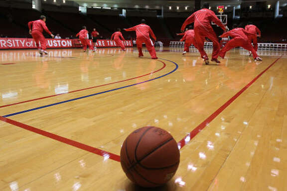 Houston's players warm up before facing Nicholls State at Hofheinz Pavilion.