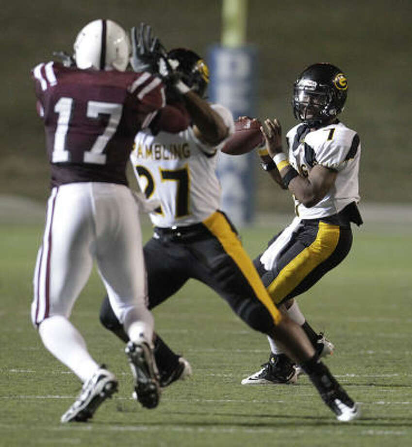Grambling's QB Anthony Carrothers(7) drops back to pass the ball during the second half. Photo: Karen Warren, Chronicle