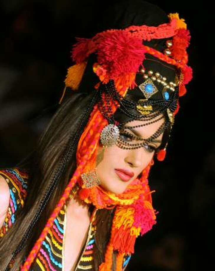 Pakistani designer Akif Mahmood goes for bright and bohemian. Photo: RIZWAN TABASSUM, AFP/Getty Images