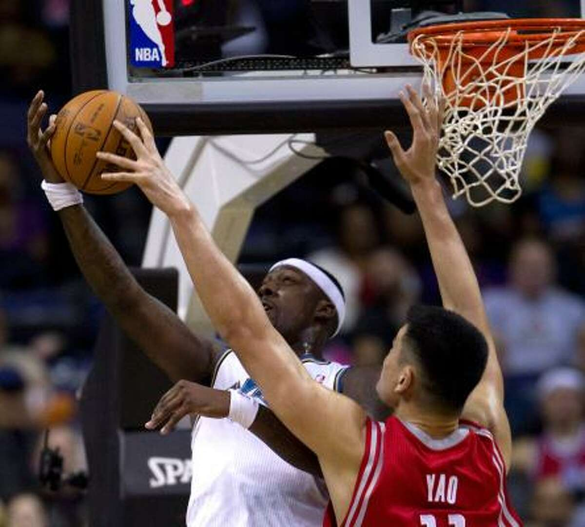 Nov. 10: Wizards 98, Rockets 1 Rockets center Yao Ming (11) blocks a shot from Wizards power forward Andray Blatche during Wednesday's game. The Rockets fell to 1-6 with the loss.