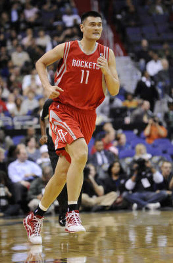 Rockets center Yao Ming runs up the court during the first half. He played only six minutes before leaving with a strained leg tendon. Photo: Nick Wass, AP