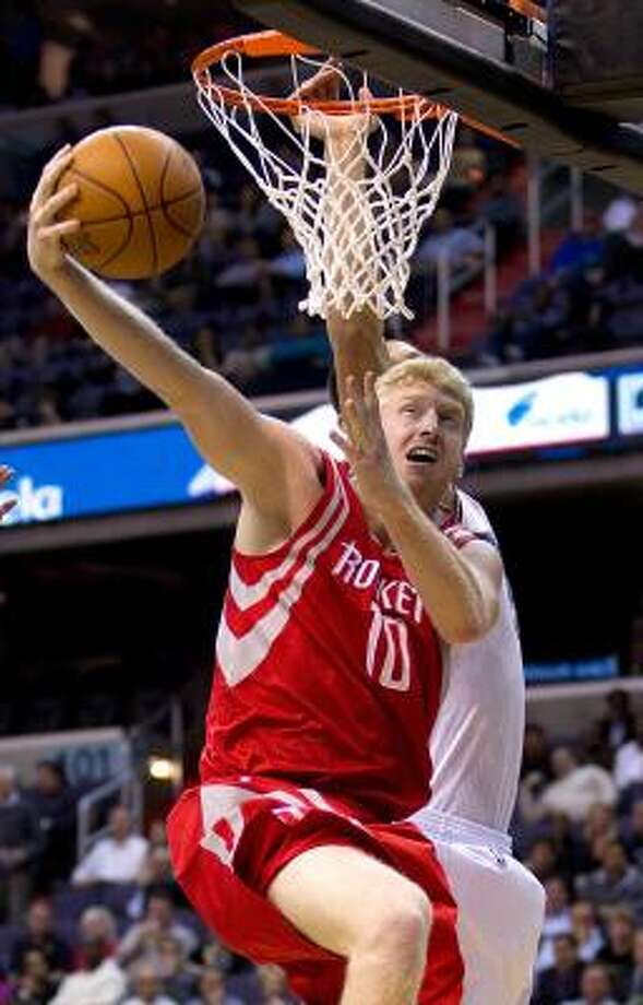 Rockets forward Chase Budinger (10) shoots over Wizards forward Yi Jianlian. Photo: HARRY E. WALKER, MCT