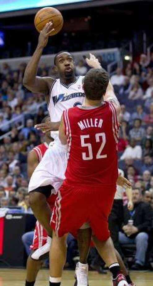 Wizards guard Gilbert Arenas charges into Rockets center Brad Miller. Photo: HARRY E. WALKER, MCT