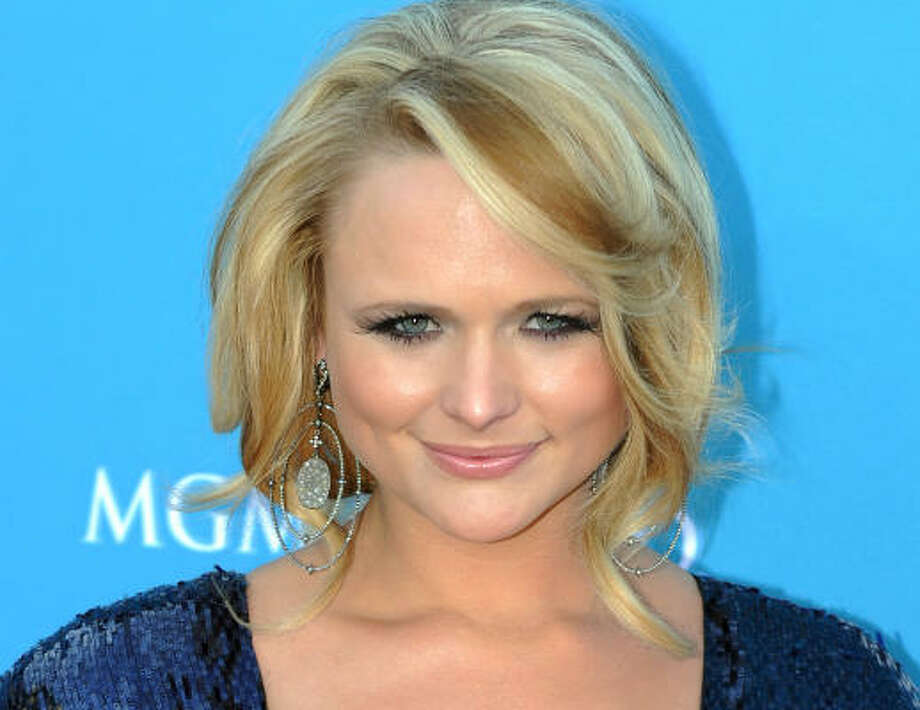 "Miranda Lambert for Entertainer of the Year, Female Vocalist of the Year,  Album of the Year, Single of the Year (""The House That Built Me"", ""White Liar""), Song of the Year (""White Liar""), Music Video (""The House That Built Me"", ""White Liar""). Photo: GABRIEL BOUYS, AFP/Getty Images"