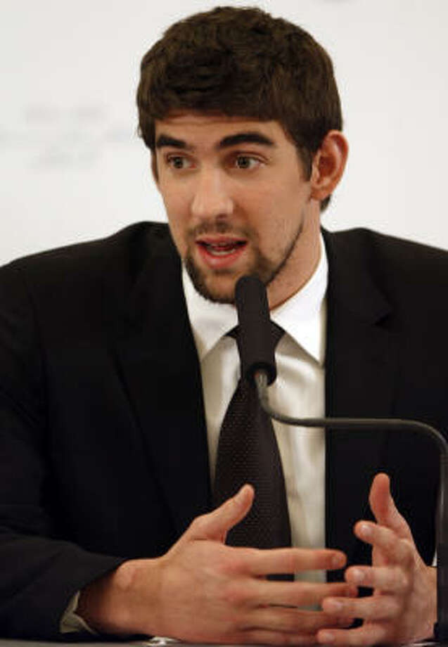 Michael Phelps found himself in hot (bong)water when photos surfaced showing the Olympic gold medalist inhaling from a marijuana pipe. Photo: Hassan Ammar, AP
