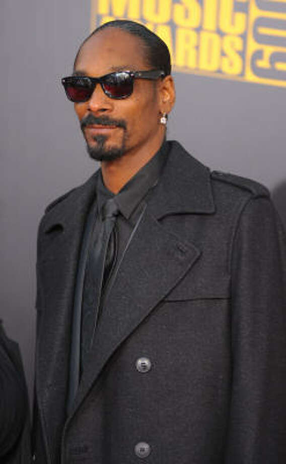 Snoop Dogg (now known as Snoop Lion) returned to the marijuana spotlight  when his son, Cordell Broadus, posted Twitter photos in which he  appears to light a bong for his father, Fox News reports. Photo: Jason Merritt, Getty Images