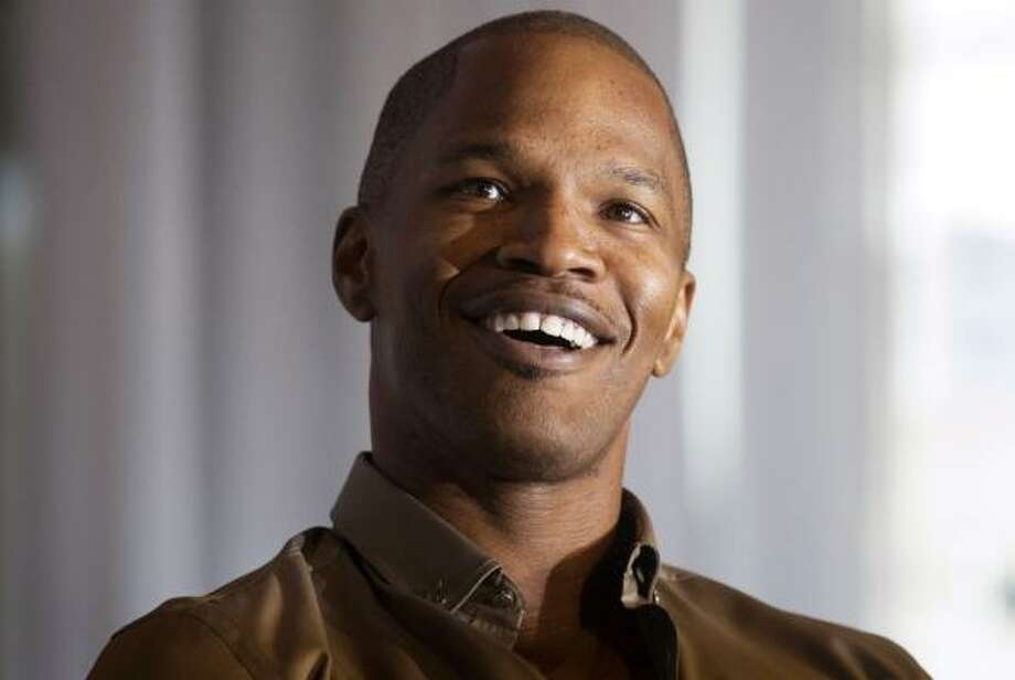 "Jamie Foxx was disappointed California's new medical marijuana bill didn't pass during mid-term U.S. elections and said, ""I was baked while I was in there voting, and I don't remember what I voted for... Everybody knows that I do (marijuana)... I've got weed-smoking lips."" Photo: Darren Calabrese, AP"