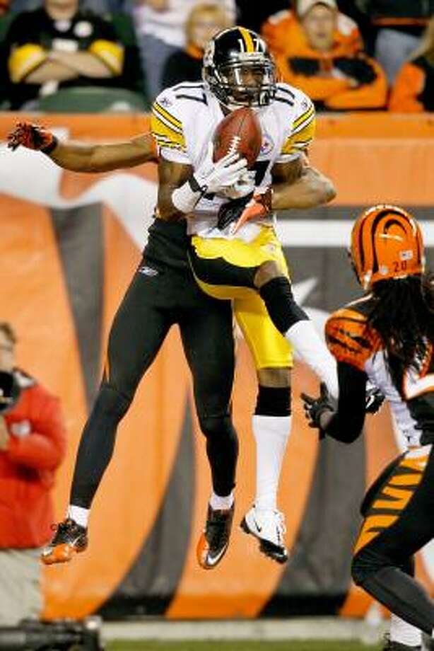 Nov. 8: Steelers 27, Bengals 21Steelers receiver Mike Wallace catches a pass for a touchdown against Bengals cornerback Leon Hall. Photo: Matthew Stockman, Getty Images