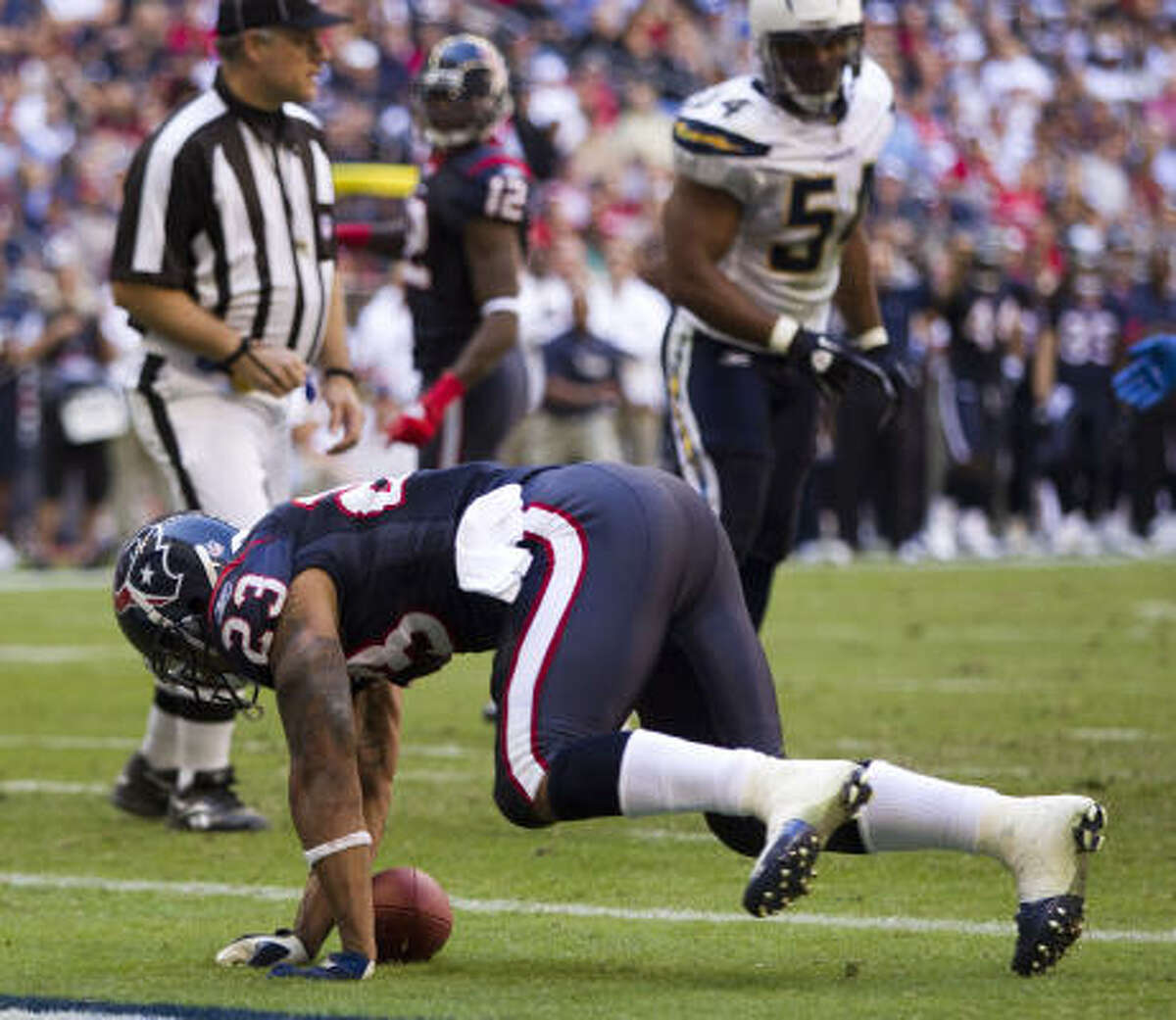 Nov. 7: Chargers 29, Texans 23 Texans running back Arian Foster (23) loses the handle on the football after crossing the goal line for an apparent touchdown. After a review of the play, it was ruled that Foster lost control of the ball as he came down in the end zone for an incomplete pass.