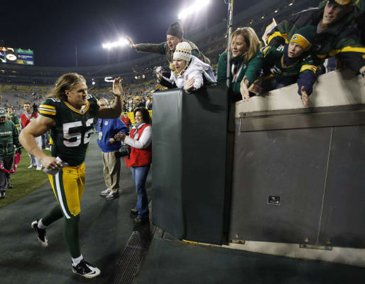 Packers 45, Cowboys 7 Packers linebacker Clay Matthews (52) celebrates with fans after defeating the Cowboys. Matthews had two tackles, a sack, an interception, a pass defensed and a 62-yard touchdown against the Cowboys.