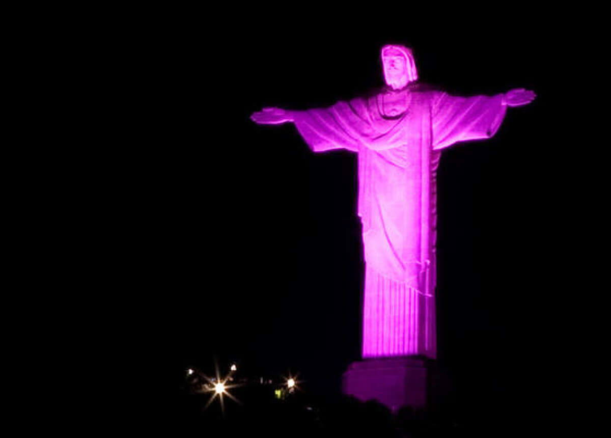 Rio de Janeiro, Brazil The Christ the Redeemer statue is lit up in pink lights for Breast Cancer Awareness Month.