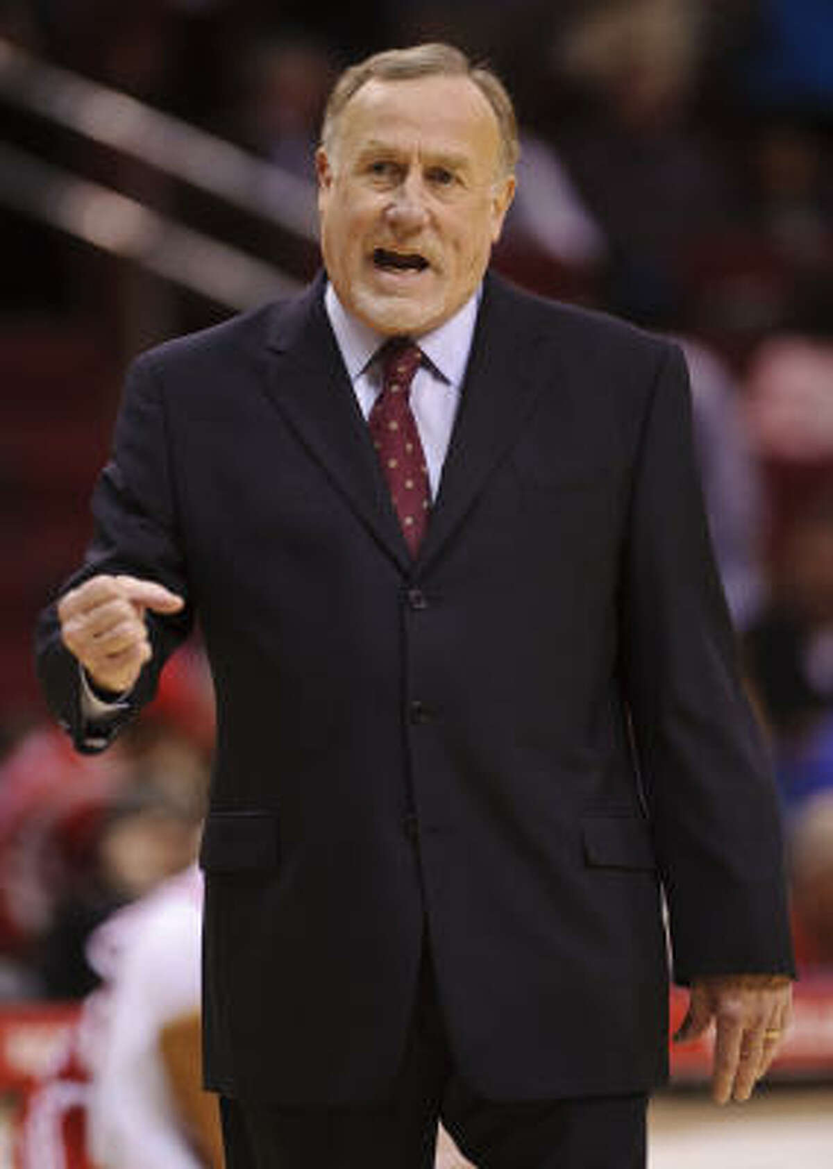Rockets coach Rick Adelman reacts to a call during the first quarter.