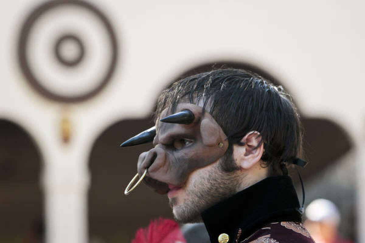 Larry Weber wears a mask at the Texas Renaissance Festival in Plantersville, Tx.