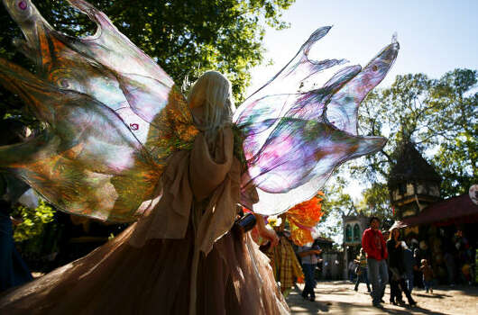 Queen Titania of the Fantasy Realm is led by a group of ferries at the Texas Renaissance Festival in Plantersville, Tx. Photo: Michael Paulsen, Houston Chronicle