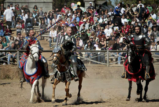"Knights from England (left to right), France and Spain battle for a ring using their lances during a jousting performance at the Texas Renaissance Festival, in Plantersville, Tx. ""Running at the Rings"" dates to the days of James I of England demonstrating a Knight's skill. Photo: Michael Paulsen, Houston Chronicle"