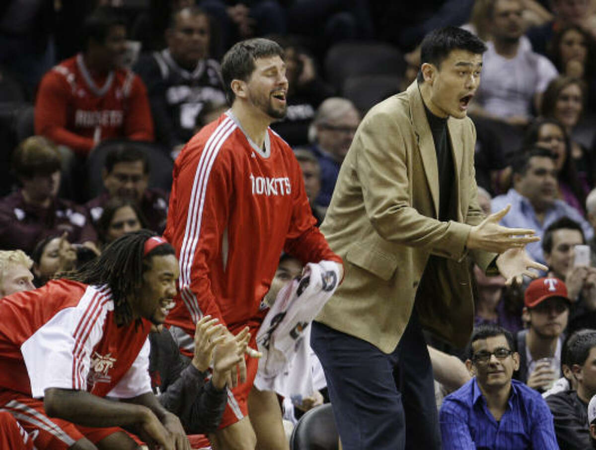 Rockets center Yao Ming, front right, and teammates react during the fourth quarter.