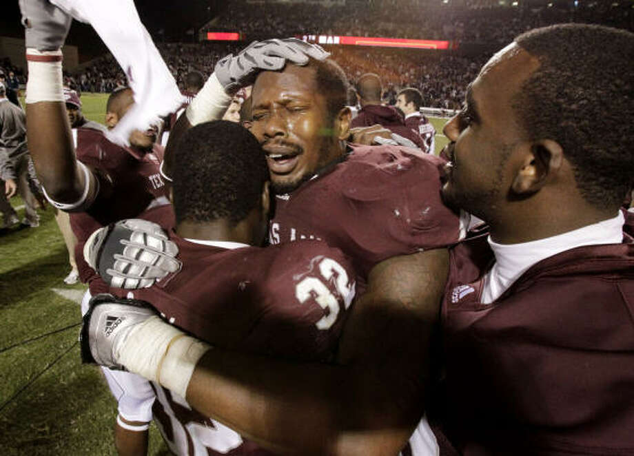 Nov. 6: Texas A&M 33, No. 11 Oklahoma 19 Defensive end Von Miller, center, and the Aggies beat Oklahoma for the first time since 2002. Photo: Julio Cortez, Chronicle