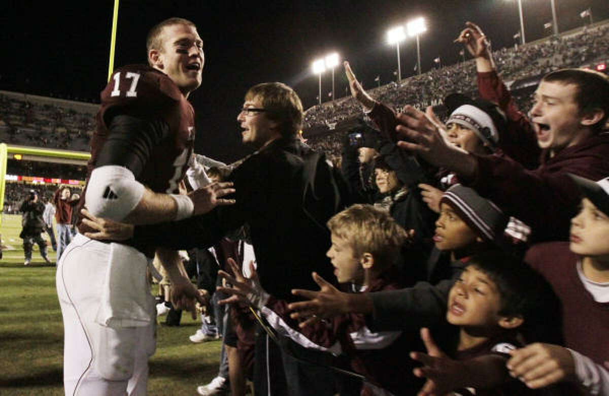 Texas A&M quarterback Ryan Tannehill (17) is congratulated by fans while leaving Kyle Field.