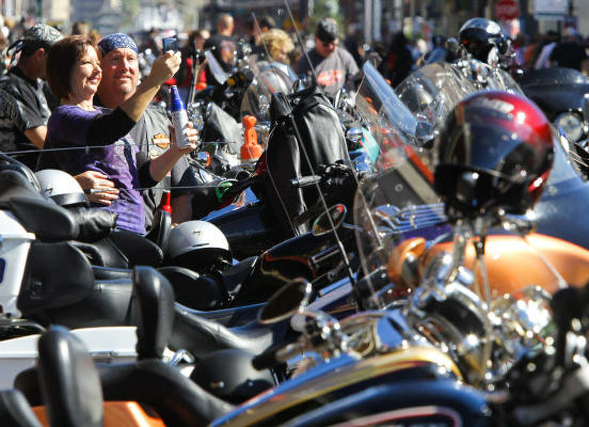 Juli Schmoke, left, and her husband, Robert, both of League City, rest on their Harley.