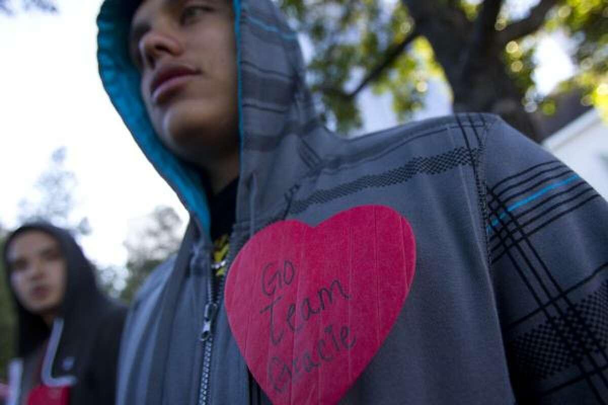 Kevin Orona, 19, wears a heart honoring his girlfriend's aunt Gracie Madrigal before walking the 2010 Start! Houston Heart Walk five-mile walk down Allen Parkway.