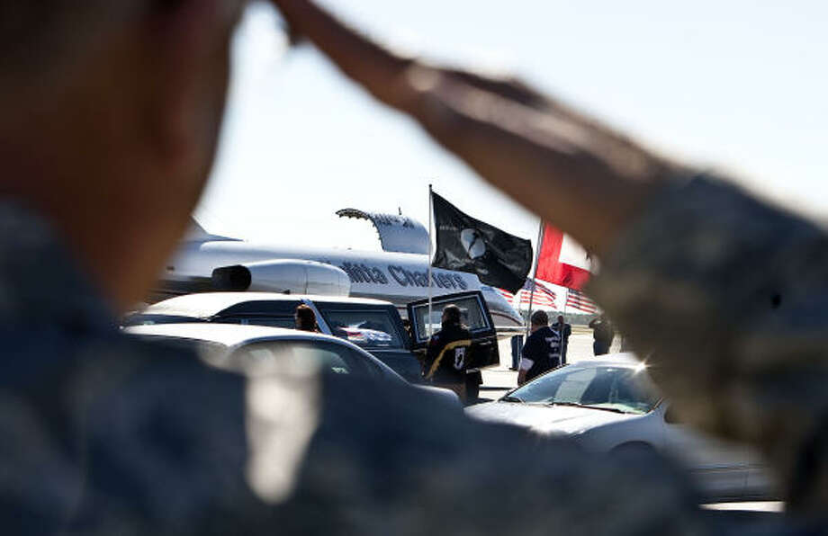 Air Force Master Sgt. Dale Hanson salutes as Army Spc. Pedro Maldonado's body is returned to Houston after Maldonado was killed in Afghanistan, at Ellington Field Saturday, Nov. 6, 2010, in Houston. Photo: James Nielsen, Houston Chronicle