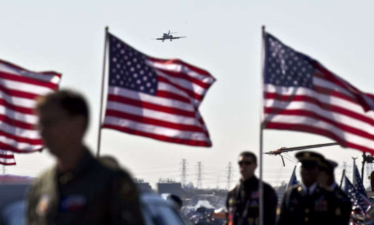 A charter jet approaches Ellington Field with the body of Army Spc. Pedro Maldonado who was killed in Afghanistan.