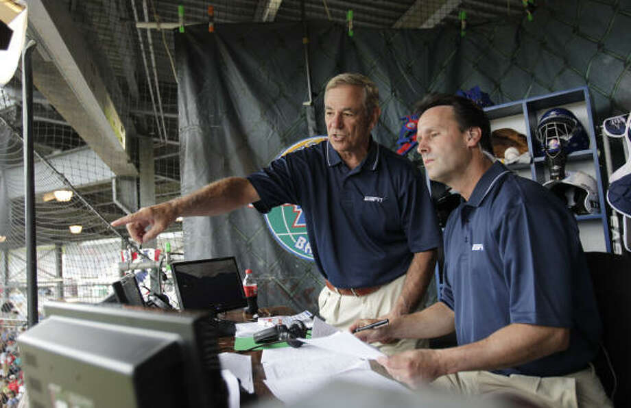 ESPN's Bobby Valentine, left, and Karl Ravech traded in their duties as MLB analysts for the task of covering 11- and 12-year-olds at the Little League World Series. Photo: Karen Warren, Chronicle