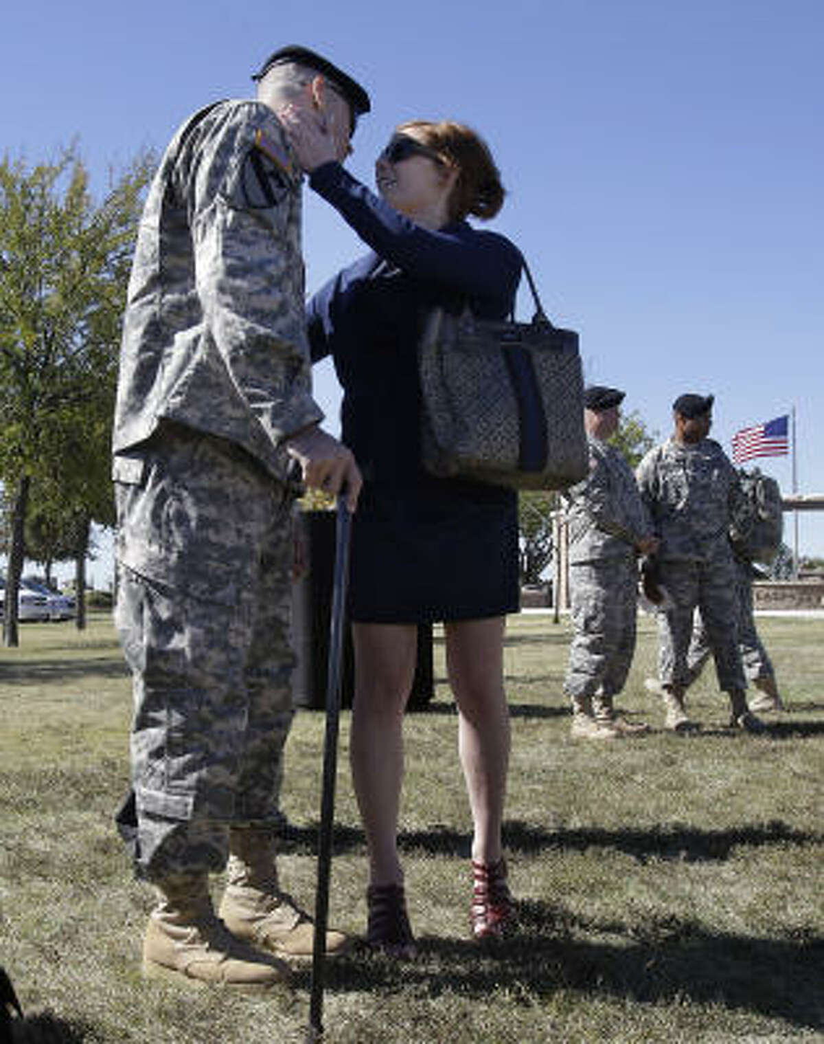 Staff Sgt. Patrick Zeigler, left, and fiancee Jessica Hansen arrive for a Remembrance Ceremony commemorating the one-year anniversary of the worst mass shooting on a U.S. military base, where 13 people were killed and dozens wounded, Friday, Nov. 5, 2010, in Fort Hood, Texas. Zeigler was shot four times and is partially paralyzed.