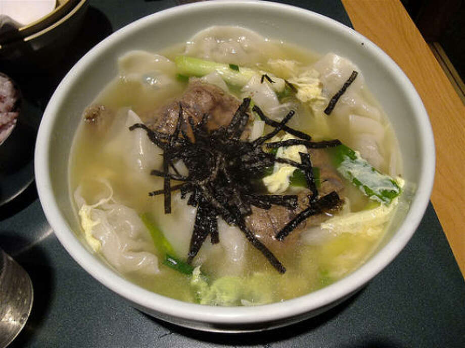 Dumpling soup at Bon Ga Korean restaurant at 9816 Long Point Rd. The wontons are filled with an unusually good beef mixture. That's seaweed on top. Photo: Alison Cook, Chronicle