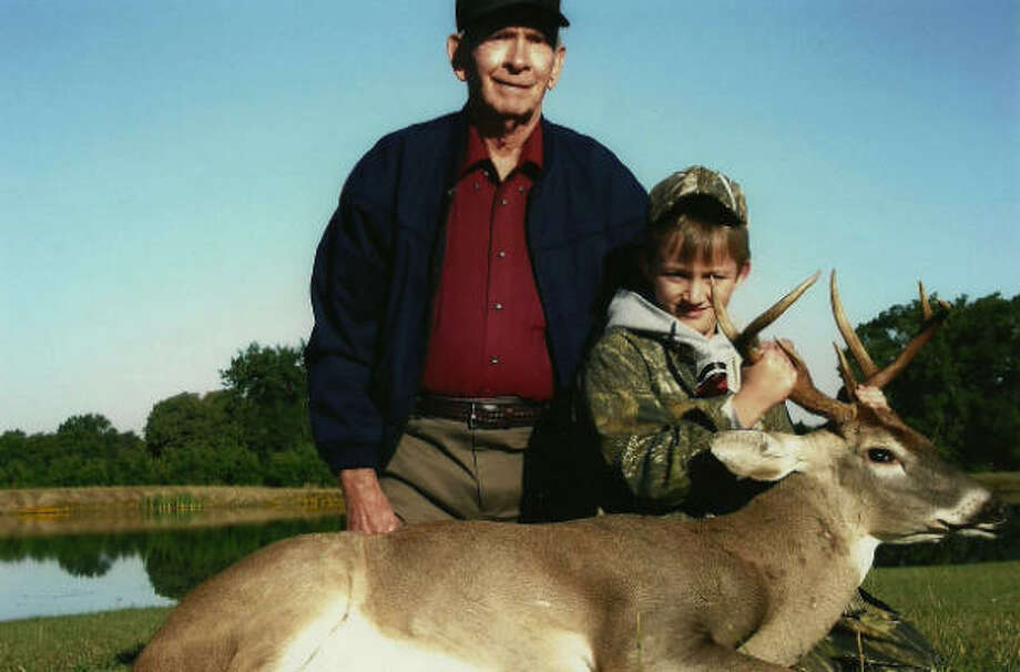 Caleb Hood, with the deer he took in Austonio. (Originally published in 2010) Photo: Special To The Chronicle